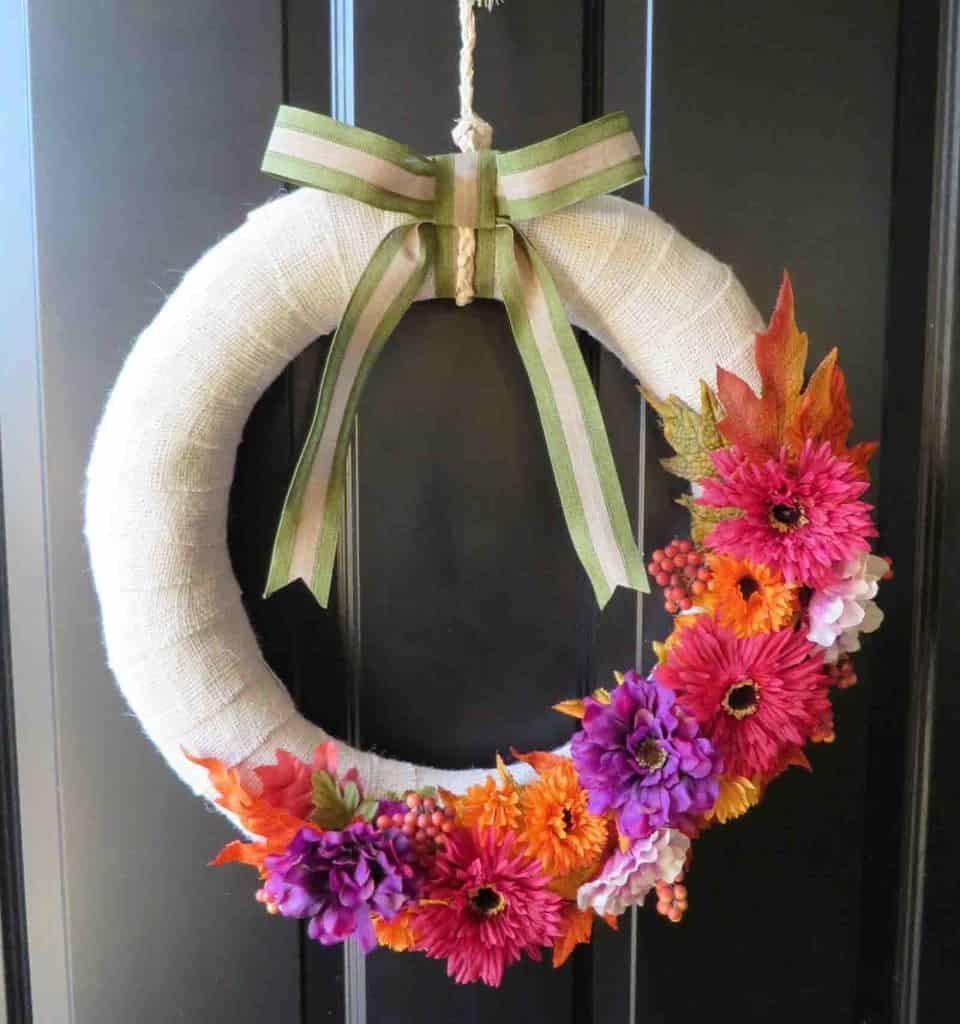 Decorate your home for fall with this easy DIY interchangeable fall burlap wreath! This wreath is interchangeable, so you can use it for every holiday and season!   decorbytheseashore.com