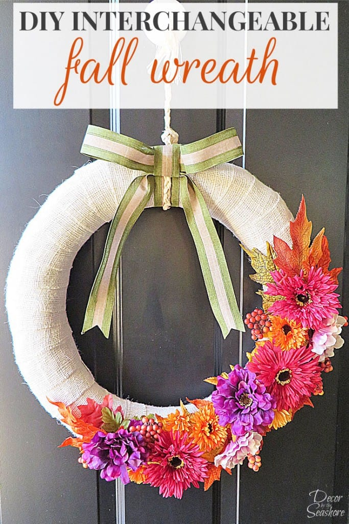 Decorate your home for fall with this easy DIY interchangeable fall burlap wreath! This wreath is interchangeable, so you can use it for every holiday and season! | decorbytheseashore.com