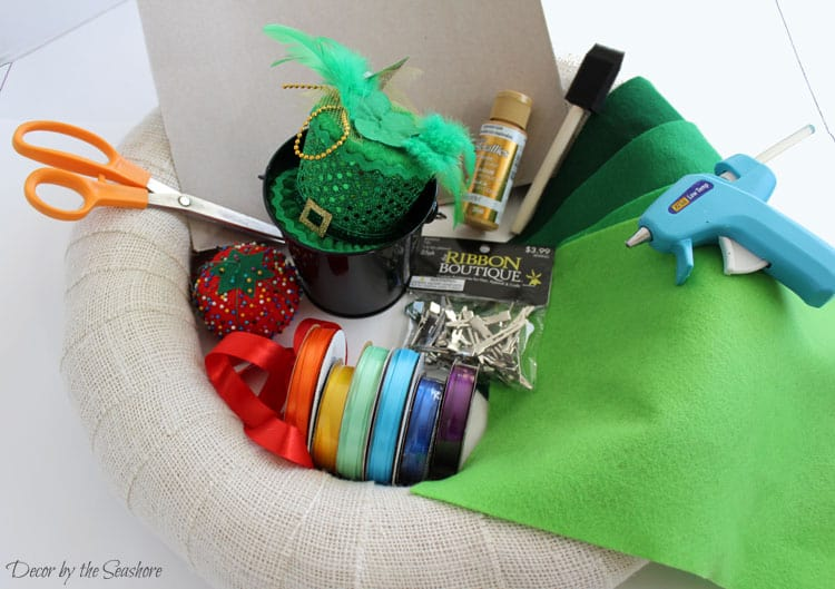 In need of some fun and colorful St. Patrick's Day decorations? Make your own DIY St. Patrick's Day burlap wreath to hang on your door for a bit of good luck! Check out the link for easy step by step instructions showing you exactly how to make this amazing St. Patrick's Day wreath! | decorbytheseashore.com