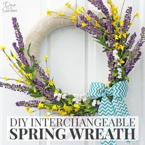 What a beautiful way to welcome spring! The colors on this DIY spring wreath are just gorgeous! And the best part is, when the season's over, just change out the accessories for the next holiday! There's no need to buy and store a bunch of extra wreath forms! Um, yes please! | decorbytheseashore.com