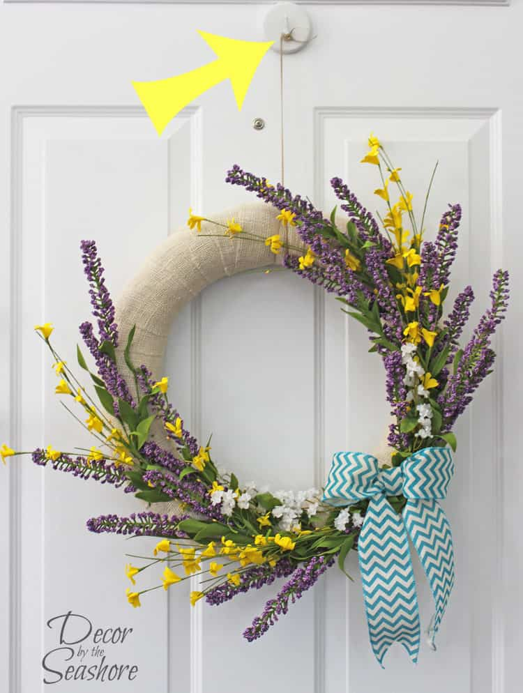 This is a GENIUS way to hang a wreath without damaging the door! I love to have a wreath on my door for every holiday, and I can't believe I didn't figure this out sooner! | decorbytheseashore.com