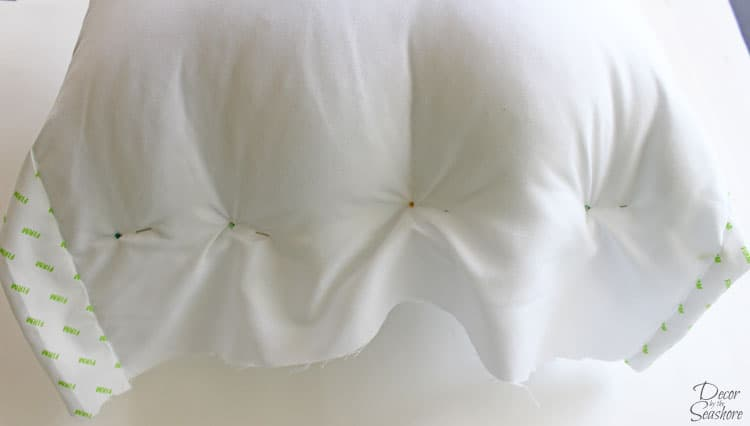 I had no idea it was so easy to turn a bed pillow into throw pillows! Throw pillows are so overpriced, and this easy tutorial shows you how to make TWO throw pillows for less than $10! What an amazing bargain! I am all about saving money with DIY home decor. Can't wait to try it for myself! | decorbytheseashore.com