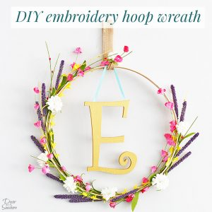 This DIY monogram embroidery hoop wreath is so elegant and beautiful! Just gather a few supplies and follow the easy instructions to make your own! This floral wreath is the perfect piece of DIY home decor to display in your home! | decorbytheseashore.com